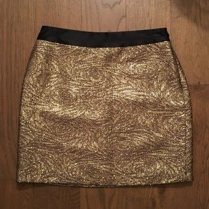 MILLY gold thread and black silk mini skirt